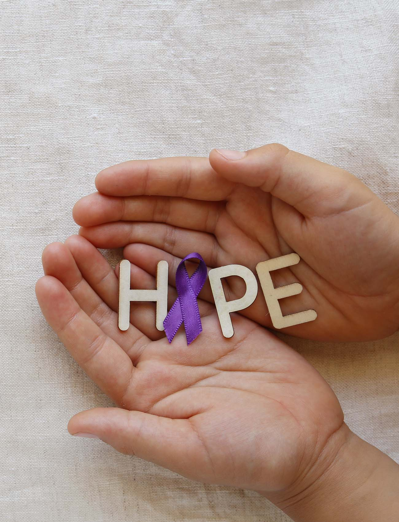 Hands Holding Purple Ribbon Representing Hope For Recovery AICDAC